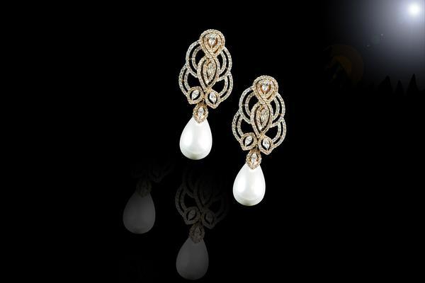 Piękne i wiszące perłowe kolczyki